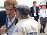 Best of friends! Prince Harry and racing legend Sir Jackie Stewart are deep in conversation during Grand Prix at Silverstone