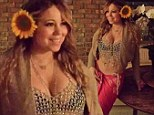 Exotic: Mariah Carey showed off her ample cleavage and washboard abs in a beaded crop top and pink sarong in an image she tweeted at 2am from New York on Friday