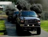 The trucks are able to create copious amount of smoke on demand, enabling them to spew it on unsuspecting cars. They call the soot 'Prius repellant'
