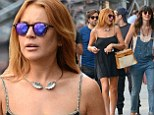 Are they Brazil nuts? Lindsay Lohan and sister Ali look sad as they leave cafe in New York after watching Germany crush World Cup hosts