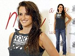 Forgotten the Blow dry? Usually glam Penelope Cruz steps out with wet hair wearing jeans and a T-shirt to press conference