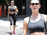 Bare you are! Emmy Rossum shows off slender midsection in form-fitting black sports bra and leggings