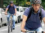 Comedian on bike without coffee! Jerry Seinfeld, 60, shows off his toned arms as he goes cycling in New York