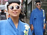 Do What You Want! Lady Gaga hits the yoga studio in a luxurious blue satin kimono in the middle of ArtPop tour