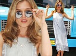 Start me up! Georgia May Jagger, wearing a long silk dress and a pair of trendy sunglasses, poses in front of a bus in Times Square for new ad campaign