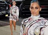 Glam gal: Nicole Richie showed off her thin pins in a sexy printed mini dress as she stepped out in New York Monday evening