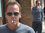 Indulging in another vice! Kiefer Sutherland puffs away on cigarette days after denying he has a drink problem
