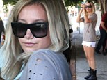 Chin on shoulder: Ashley Tisdale showed her model good looks on Tuesday as she left a hair salon in West Hollywood, California