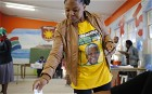 A woman wearing a Nelson Mandela t-shirt casts her ballot in the township of Nyanga on the outskirts of Cape Town