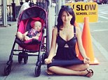Let's hope that sidewalk was cleaned recently: Hilaria Baldwin plunks herself down on NYC street for latest yoga pose... as her daughter looks on