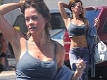 Cool it! A crop-top wearing Brooke Burke, 42, uses her toned arms to squeeze the sweat out of her hair after a grueling cycling workout in Malibu