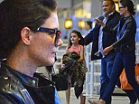 Back home with mama! Katie Holmes, incognito in sunglasses and black leather jacket, picks up daughter Suri from JFK after the eight-year-old¿s Ohio visit with Katie¿s parents