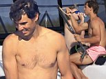 Reeling it in: Rafael Nadal takes his mind of Wimbledon loss as he spearfishes with friends in Ibiza