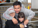 FILE - This undated file photo provided Tuesday April 5, 2011 by John Stow shows Bryan Stow holding his 12-year-old son and 8-year-old daughter. Bryan Stow a...