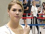 Time to blend in! Kate Upton chooses comfort over style in loose-fitting black trousers as she catches flight out of Detroit