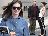 Showing who's boss! Anne Hathaway gets to work on The Intern in denim shirt... before taking a break to lark around with costar Robert De Niro