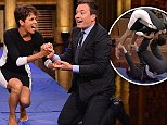 She falls head over heels for him! Halle Berry takes a tumble with Jimmy Fallon as they make a human hamster wheel