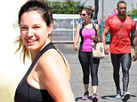 Gym buddies! Kelly Brook goes make-up free as she cycles to the gym with fiance David McIntosh... who turns heads in tight wet-look leggings