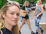 Candice Swanepoel shows off white bra in revealing top before flashing her legs in TINY T-shirt dress in second outfit of the day