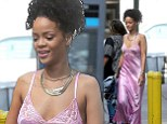 Just rolled out of bed? Rihanna leaves little to the imagination in pink satin nightdress and trainers