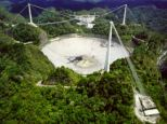 The discovery of a split-second burst of radio waves by scientists using the Arecibo radio telescope in Puerto Rico raises major new questions over what caused it.