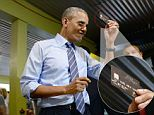 Presidential digits: President Obama brazenly flashed his credit card Thursday during a dinner stop for Texas barbecue as he prepared to leave Austin