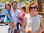 Awwww... Alyson Hannigan's husband Alexis Denisof proved what a hands-on dad he is during a family outing to the Brentwood Country Mart in Los Angeles on Thursday