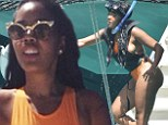 Aquatic adventures: Angela Simmons showed off her stunning hourglass figure in a neon orange monokini while snorkelling in Barbados on Wednesday