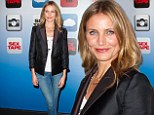 Demure: Cameron Diaz kept covered up in a militaristic blazer teamed with skinny jeans while at a photocall for new film Sex Tape in Los Angeles on Thursday