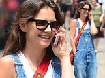 Make-up free Katie Holmes dons denim dungarees as she happily chats on her pink iPhone in NYC