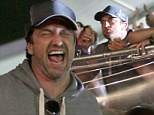 He's on to a winner! Gerard Butler is all smiles as he watches Argentina beat Holland at the Brazil World Cup semi-final