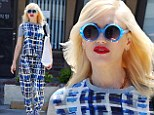 Bold and blue: New mother Gwen Stefani shows off fashion-forward mindset with checkered top and matching trousers
