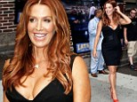 Baby announcement: Poppy Montgomery shows her baby bump on Wednesday as she arrives for a taping of the Late Show with David Letterman in New York City