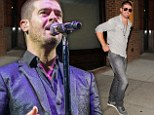 Weak sales: Robin Thicke, shown performing on Sunday in London, has seen his new album Paula experience poor sales in its first week
