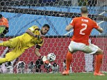 Drama: Goalkeeper Sergio Romero saves the penalty of Holland's Ron Vlaar during the shootout