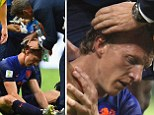 Ouch! Kuyt gets a staple gun to the head