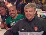 Club promotion: Wenger is photographed wearing an Arsenal training jacket while out for dinner