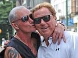 Pucker up: Football legend Paul Gasgoigne plants a kiss on QPR manager Harry Redknapp