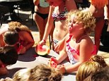 Honey Boo Boo demolishes the competition in a water melon contest while on vacation with her family in Panama City, Florida