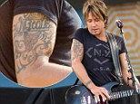 Wearing his heart on his sleeve! Keith Urban shows off his 'Nicole' tattoo as he wows Central Park crowd in New York