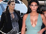 Really, Kim? Fashion forward Kardashian advises pregnant women to hide their bodies in 'a big blanket' and 'never leave the house' in new interview