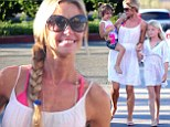 Mommy loves all of you! Denise Richards showers all three daughters with smiles and affection as they take a family stroll through Malibu