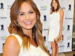 Beaming Stacy Keibler displays her bump in a frilly white mini dress while test-driving baby strollers