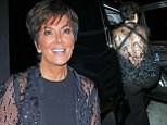 Keeping up with her daughters? Kris Jenner flashes her back in a feathery see-through ensemble as she dines in West Hollywood