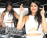 Walia-ing out the tunes: TOWIE's Jasmin Walia pushes the DJ aside and takes to the decks in white cut out crop top and the polo