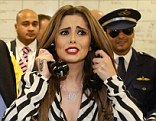 Cheryl Cole (in zebra stripes) with  Michael Spencer at a charity event. Cole has recently closed an Irish company