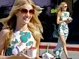 Twice as nice! Rosie Huntington-Whiteley is summer personified as she grabs two cups of ice cream in a floral dress with a daring thigh high split