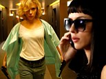 Gun-toting Scarlett Johansson shows her action girl credentials in the new Luc Besson movie, Lucy