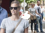 Model Bar Rafaeli opts for laid-back chic in distressed jeans to go shopping with her brother