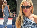 Affectionate: Rachel Zoe wore a chic heart-printed maxi dress as she took her son Skyler out in Beverly Hills, California on Saturday